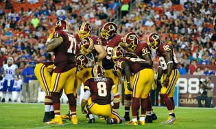 Aug 26, 2016; Landover, MD, USA; Washington Redskins quarterback Kirk Cousins (8) and Washington Redskins huddle against the Buffalo Bills during the first half at FedEx Field. Mandatory Credit: Brad Mills-USA TODAY Sports